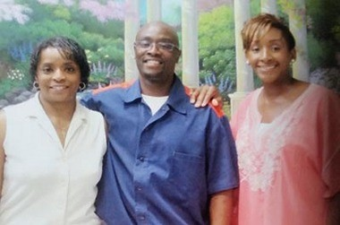 Bosie Smith, center, with his aunt, Deborah Kay Long, left, and cousin Laquanda Marshall, right.