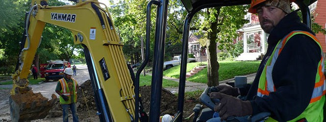 Jerry Dalrymple runs the excavator as the hole gets deeper.