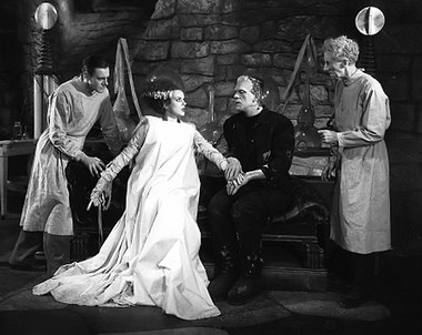 """A scene from the 1935 film """"Bride of Frankenstein"""" starring Colin Clive, Boris Karloff and Elsa Lanchester."""