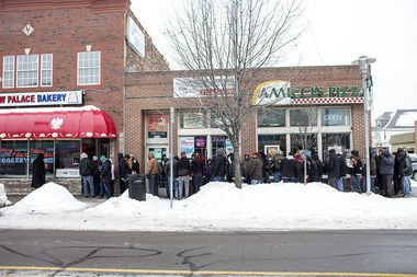 The line for paczkis at New Palace Bakery in Hamtramck wraps around the block on Paczki Day 2014, Tuesday, March 4. Paczki Day is the Polish version of Fat Tuesday, celebrating the last day of indulgence before Ash Wednesday and the beginning of Lent. Many people celebrate by eating paczkis, a Polish donut pastry, and drinking with friends.