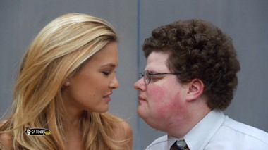 Super Bowl 2013 commercials: Supermodel Bar Refaeli is about to plant a kiss on a Go Daddy tech.
