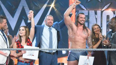 "Sara Lee and Josh receive their $250,000 WWE contracts after winning WWE ""Tough Enough"" on August 25, 2015"