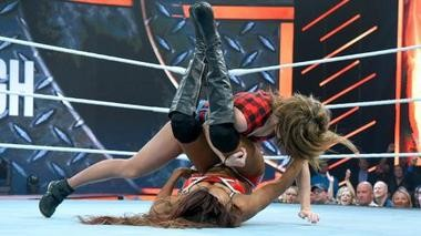 "Sara Lee takes on WWE Diva Alicia Fox in the ring at the WWE ""Tough Enough"" finale Aug. 25."