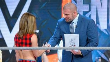 "WWE COO Triple H congratulates Sara Lee on winning WWE ""Tough Enough"" and the $250,000 WWE contract Aug. 25, 2015."