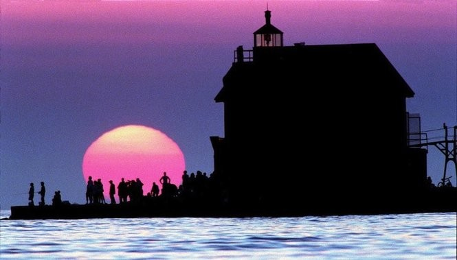 Visitors to the Grand Haven south pier watch the sun set over Lake Michigan. (Ken Stevens/MLive.com files)