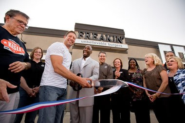 Ribbon cutting ceremony left to right: Frank Kasle (Flint Twp trustee), Joan Thornton (General Manager), Greg White (Business Partner), Mateen Cleaves (Former Michigan State Basketball Player), Brent Skaggs (Owner), Supervisor Karyn Miller, Belenda Parker (Flint Twp trustee), Barb Vert (Flint Twp trustee), Debbie Garrison (Genesee Regional Chamber representative). Freakin' Unbelievable Burgers holds a grand opening celebration Saturday May 19th, 2012, the store will open for regular business Monday May 21st, 2012.