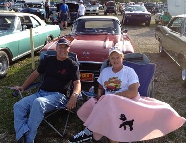 Jerry and Janet Koryciak sit in front of their 1962 Corvette at the 2012 Back to the Bricks kickoff party at the U.S. 23 Drive-in. The couple, married eight years, started dating 50 years ago, and some of those first dates were at the drive-in.