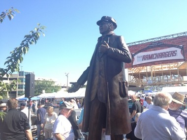 A statue of General Motors founder William C. Durant is unveiled at the 9th Annual Back To The Bricks car show in Flint on Saturday, Aug. 17, 2013.