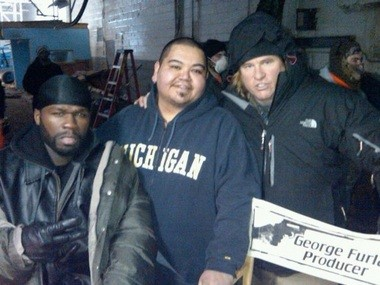 """Flint actor Josh Carrizales poses with rapper/actor Curtis """"50 Cent"""" Jackson and actor Val Kilmer on the set of """"When Things Fall Apart."""""""
