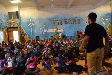 """Children attend an anti-bullying assembly during the """"Schooled: Groovy Projects"""" program."""