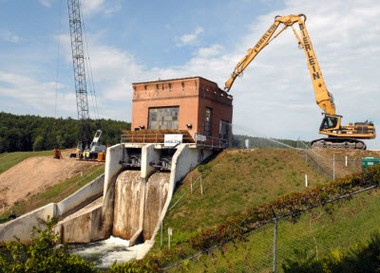 Demolition work on the Brown Bridge dam on the Boardman River is shown in this 2012 photo. Flooding earlier this year has prompted criticism of the Boardman dam removal efforts. (Bridge photo/John Russell)