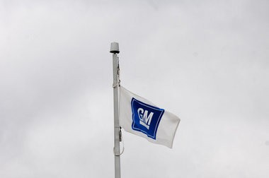 A flag waves in the wind outside of the Flint Engine Operations plant on Bristol Road on March 7, 2013 in Flint