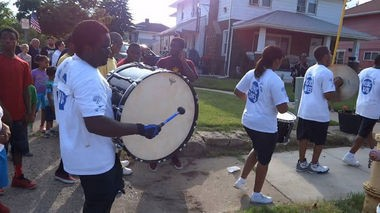 Nightfire Drumline led about 140 people through the streets of a north side neighborhood for the first Neighborhood Art Parade in conjunction with the Flint Public Art Project and Neighborhood Restoration Coalition. (Photo submitted by Kayla Latham)