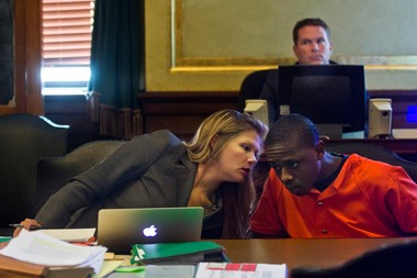 Juwan Wickware, 19, talks with his defense attorney Jodi Hemingway before his sentencing by Genesee Circuit Judge Archie Hayman at the Genesee County Court House on Friday, Aug. 9, 2013. Zack Wittman   MLive.com