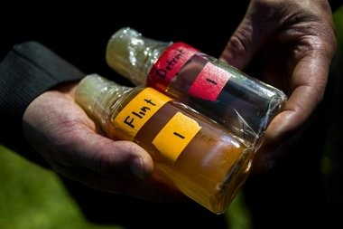 Virginia Tech professor Marc Edwards shows the difference in water quality between Detroit and Flint after testing during a Sept. 15 news conference in Flint.
