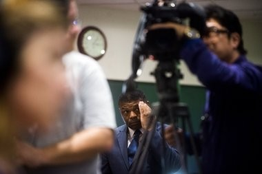 Howard Croft, director of the Flint department of Public Works, looks on behind media cameras as more than 60 gathered last week to hear doctors call for a public health advisory because of an increase in the number of children with elevated blood lead levels in Flint.