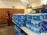 Flint Schools Superintendent Bilal Tawwab urges the community to donate bottled water to the schools during a press conference, Monday, Sept. 28.