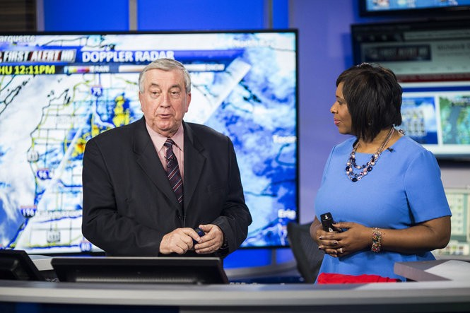 Meteorologist John McMurray explains the forecast with anchor Dawn Jones during the ABC 12 news at noon on Thursday, March 31, 2016 at the ABC 12 news station. After 47 years with the news station, McMurray will be retiring.