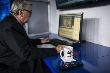 Meteorologist John McMurray prepares before a broadcast for the ABC 12 news at noon on Thursday, March 31, 2016 at the ABC 12 news station. After 47 years with the news station, McMurray will be retiring.