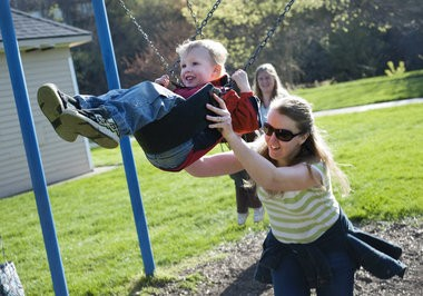 Kim Vaughn of Flushing does an underdog swing push for her son Joey Vaughn, 5, while at Riverview Park in downtown Flushing.