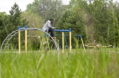 A Flint resident hangs out at Sarvis Park on Friday afternoon, May 21, 2010.
