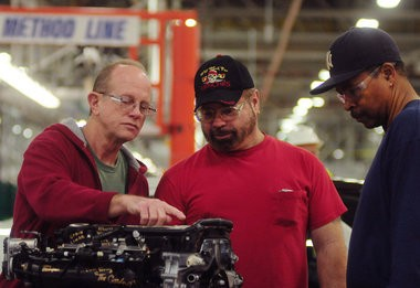 General Motors employees look over a Turbo engine at Flint Engine Operations. GM announced Thursday, April 4, it would invest $215 million for production of a new Ecotec gas engine and retooling for the V6 engine. MLive file photo