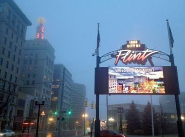 A layer of fog envelops downtown Flint.