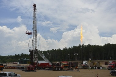 Michigan is reviewing its standards for waste collected during hydraulic fracturing and other drilling operations. Seen here, in a July 18, 2013, is a site run by Encana Corporation in a heavily wooded area between Kalkaska and Grayling, Mich.