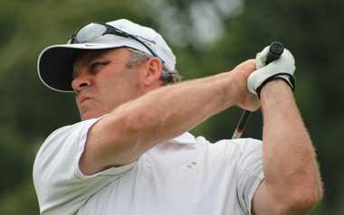 Mike Ignasiak of Saline watches his shot during play at the Michigan Amateur at Muskegon Country Club Friday.
