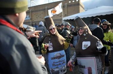 Sarah Bozarth and Megan McLeod dance in beer costumes at the Michigan Brewers Guild Winter Beer Festival in 2012.
