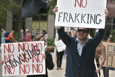 Protestors against fracking march to the Riverfront Plaza office building in downtown Grand Rapids, in September. (Chris Clark   MLive.com)