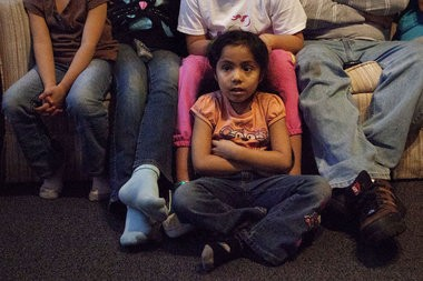 Jasmine Rojas, 5, on the floor of the temporary home she and her family were living in after losing their home when the Lexicon Club in Grand Rapids caught fire.