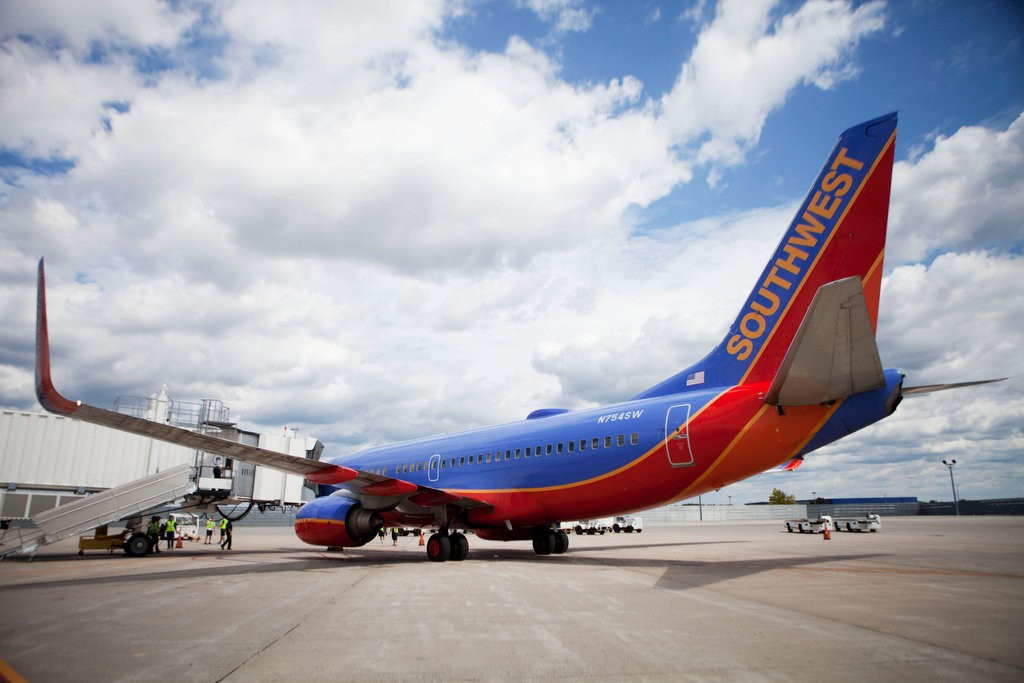The first Southwest Airlines passengers from Baltimore leave the plane in Grand Rapids at the Gerald R. Ford International Airport on Sunday, August 11, 2013.