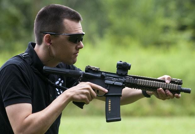 Neal Brace shows firearm muzzle brake made on 3D printer