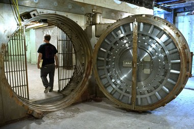 Michael Peoples walks into the bank vault in the basement of The Morton, a 90-year-old hotel building where SiTE:LAB will exhibit site-specific installations during ArtPrize 2014. Photo taken Friday, August 15, 2014 in downtown Grand Rapids, Mich. (Chris Clark   MLive.com)