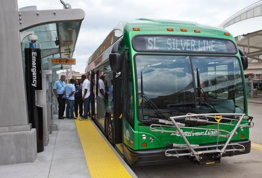 Drivers prepare get on a new Silver Line bus during a training exercise in Grand Rapids Monday, Aug. 18, 2014.