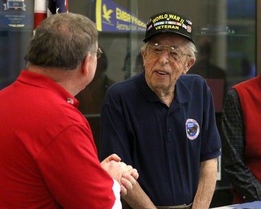 U.S. Army veteran John Slagter is introduced before speaking about his trip experience to Washington D.C. with Talons Out Honor Flight at the West Michigan Aviation Academy in Grand Rapids, Mich., Wednesday, February 11, 2015. (Hugh Carey | MLive.com)