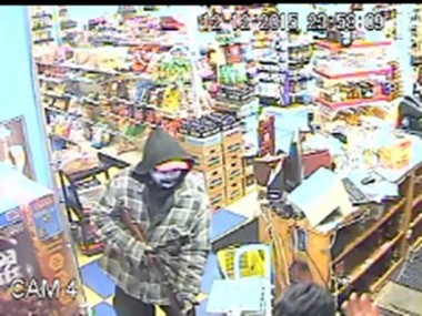 The suspect in an armed robbery at Bottlenecks Food and Drink Shop, 2355 Fuller Ave. NE