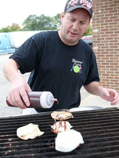 Chef Mike Burns commands the grill at his new restaurant, Burnzie's at 3097 30th St. in Grandville.