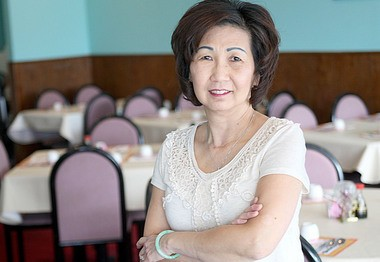 Ann Chan stands in the seating area of her new restaurant, Great China Inn, at 3901 Chicago Drive in Grandville.