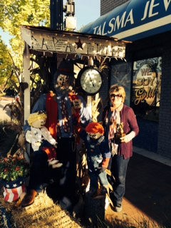 """Sharon Gort, of Talsma Jewelers, stands by her first-place scarecrow, """"Pappa Time."""