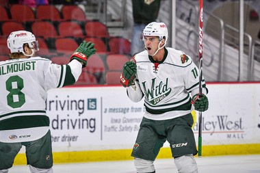 Former Griffins captain Jeff Hoggan celebrates with teammate Zach Palmquist after his first-period goal for Iowa.