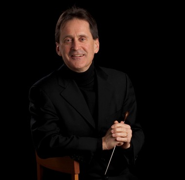 Calvin College has appointed John Varineau, longtime associate conductor of the Grand Rapids Symphony, as a full-time professor of music and director of orchestras.