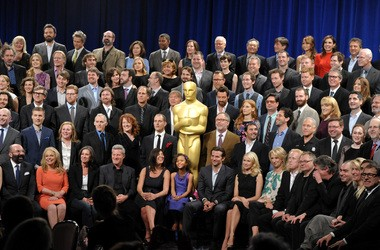 David France, with all the Oscar nominees at the Academy's annual luncheon. He is two people to the left of the Oscar statue, with his head turned.