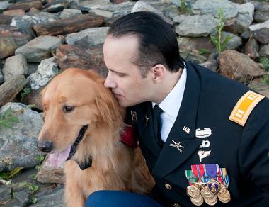 Army veteran Luis Montalván and his golden retriever service dog Tuesday