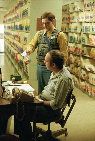 "Judah Friedlander, standing, with Paul Giamatti in a scene from ""American Splendor."""