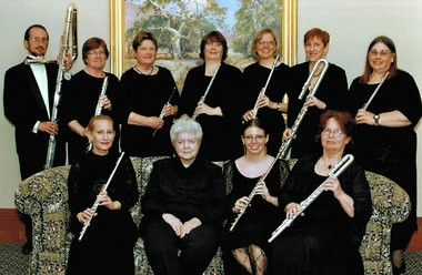 The West Michigan Flute Association's Chamber Choir directed by Darlene Dugan (seated second from left) play instruments including the contrabass flute (standing, left) and the bass flute (standing, second from right) as well as more familiar piccolos, flutes and alto flutes. (Courtesy photo)