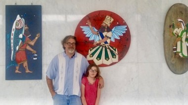 "Daniel Sarhad (left) with his daughter and his work, ""New Artifacts From an Ancient Culture."""