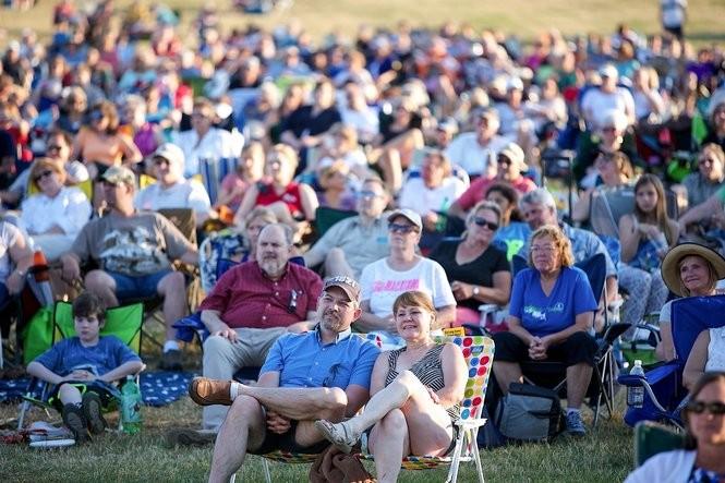 An audience enjoys an outdoor Symphony concert.