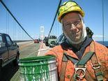 """Mike Rowe films a """"Dirty Jobs"""" episode on the Mackinac Bridge in 2007."""